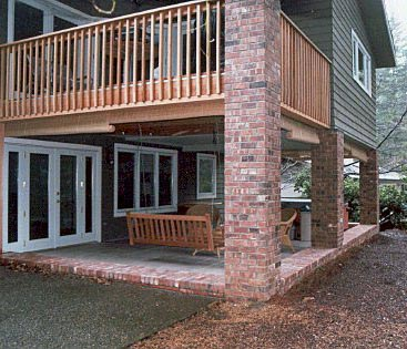 This back patio was against the forest and bugs were a real problem. The floor was not parallel to the ceiling so he added brick work to level it out. We then installed tracks and channels and 10 locking sliding patio door panels.