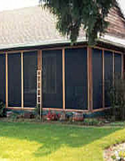 We framed it in cedar and aluminum panels with two sliding door panels at each end that lock from both sides. We also used our heavy duty Pet Mesh which will allow the cats to climb the screens to get their exercise while chasing bugs.