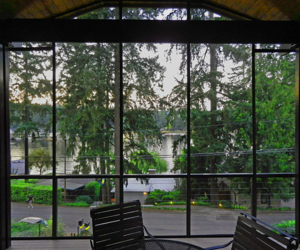 """We used the stainless steel mesh here to improve the visibility and light. The lakes view was not blocked at all except for the 1"""" frames of the screens."""