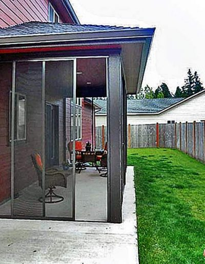 This is the same patio from the other end with a door opened up. All 10 panels are moveable as well as removable in the event a large object needs to be carried in or out.
