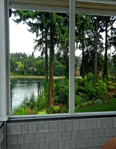Here is the view out the right side of the patio facing the Willamette River. The aluminum screen frames are covered in wood trim on the sides which gives more support to the enclosure and allows the frame work to tie in much better with the all cedar framed structure.