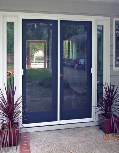 The French door has two by passing sliding patio screen doors on new tracks.
