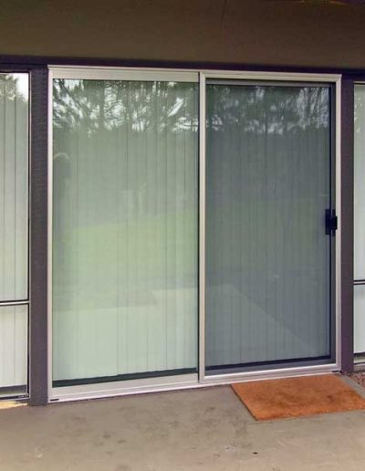 This is a standard light duty patio screen door in a mill finish with regular screen mesh.