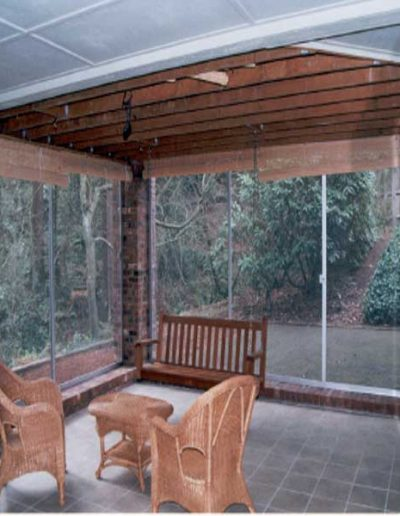 This is a patio screen enclosure we built on to brick with triple sliding screen doors that stack up on one end when needed to.