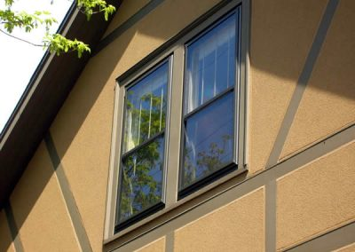This bronze colored GOOD series single hung window has an inner movable screen that slides up or down depending on which window you want to open. When there are children or pets inside the safest window to vent is the top!