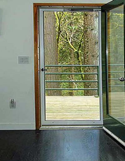 """This white screen door is the full view version with no components except that it was upgraded to the """"See Vue"""" stainless steel mesh."""