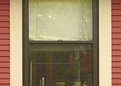 This Best series bronze colored storm window has a bottom screen and the option of having a full screen.