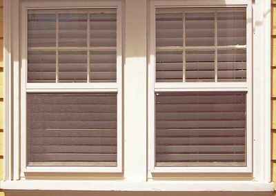 This Best series almond colored storm winow fits well with this almond window trim.