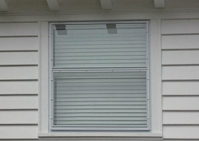 Here is a Picture storm window with the glass divided into 2 sections or lites which can be removed and traded out with screens in the warm weather.