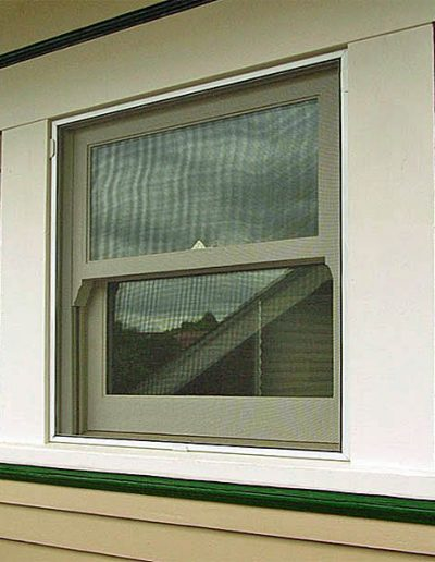 Here is a full screen covering the whole window which allows you to open the top or bottom sash for ventilation.